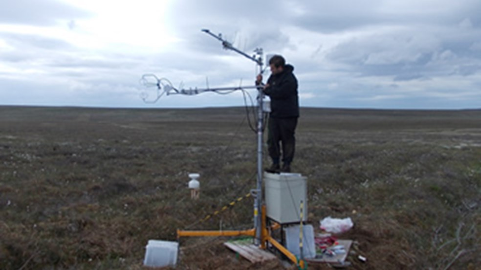 Graham Hambley of St Andrews University adjusting an eddy-covariance tower - used to make micro-meteorological measurements of greenhouse gas dynamics above the peatlands at Forsinard.