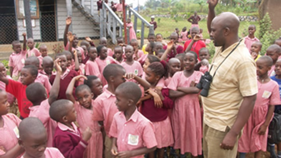Achilles Byaruhanga, Executive Director of NatureUganda teaching schoolchildren at Nabajjuzi