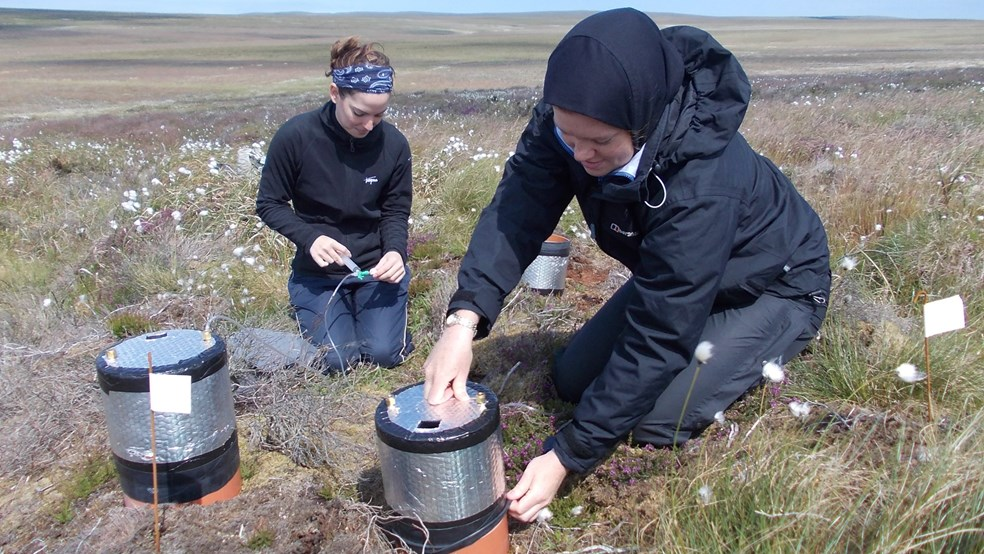 Renée Hermans of Stirling University (left) using flux chambers to measure gas exchange between the soil/vegetation surface and the atmosphere, as part of her PhD studies at Forsinard (with research technician Rebecca McKenzie (right) of the Environmental Research Institute).